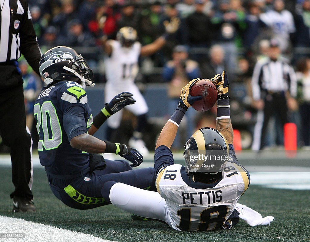 Jeremy Lane (L) #20 of the Seattle Seahawks cannot keep Austin Pettis #18 of the St. Louis Rams from making this touchdown catch in the first half at CenturyLink Field on December 30, 2012 in Seattle, Washington.