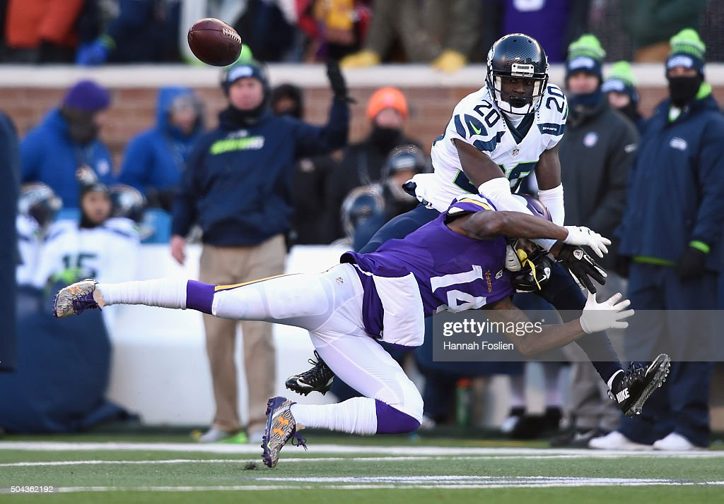 Jeremy Lane #20 of the Seattle Seahawks defends a pass intended for Stefon Diggs #14 of the Minnesota Vikings in the fourth quarter during the NFC Wild Card Playoff game at TCFBank Stadium on January 10, 2016 in Minneapolis, Minnesota.