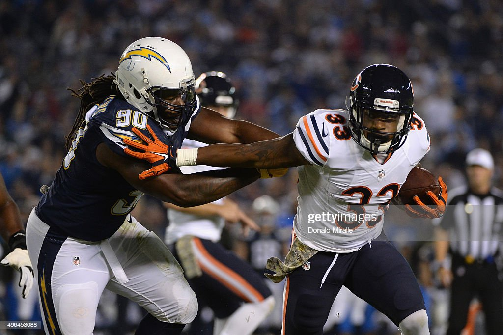 Jeremy Langford of the Chicago Bears is pursued by Ricardo Mathews of the San Diego Chargers at Qualcomm Stadium on November 9 2015 in San Diego...