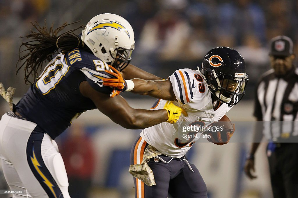Jeremy Langford of the Chicago Bears is tackled by Ricardo Mathews of the San Diego Chargers at Qualcomm Stadium on November 9 2015 in San Diego...