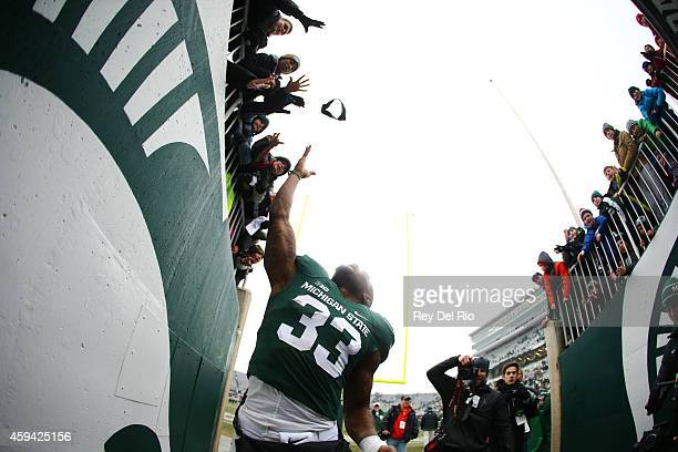 Jeremy Langford of the Michigan State Spartans celebrates with the fans after the game against Rutgers Scarlet Knights at Spartan Stadium on November...