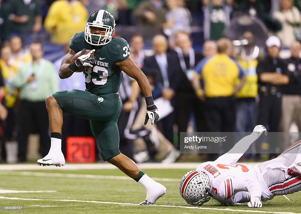 Jeremy Langford of the Michigan State Spartans out runs Corey Brown of the Ohio State Buckeyes to score the game winning touchdown of the Big Ten...