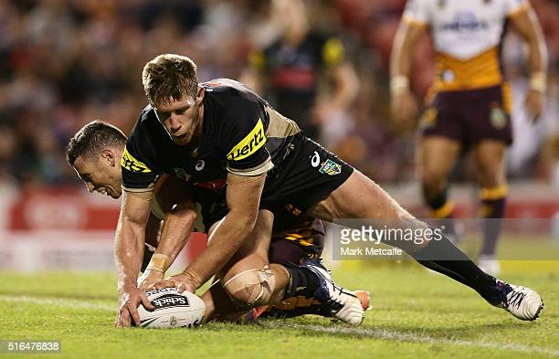 Jeremy Latimore of the Panthers beats Darius Boyd of the Broncos to the ball to score a try during the round three NRL match between the Penrith...