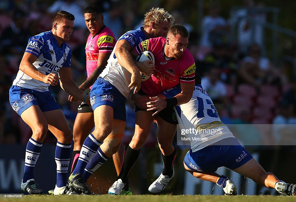 Jeremy Latimore of the Panthers is tackled during the NRL Trial match between the Canterbury Bulldogs and the Penrith Panthers at Pepper Stadium on February 13, 2016 in Sydney, Australia.