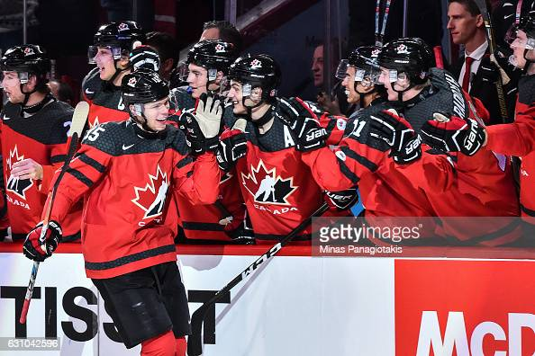 Jeremy Lauzon of Team Canada celebrates his first period goal with teammates on the bench during the 2017 IIHF World Junior Championship gold medal...