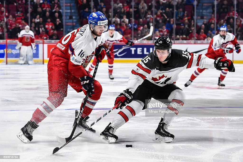 Jeremy Lauzon #15 of Team Canada skates the puck against Daniel Kurovsky #16 of Team Czech Republic during the 2017 IIHF World Junior Championship quarterfinal game at the Bell Centre on January 2, 2017 in Montreal, Quebec, Canada. Team Canada defeated Team Czech Republic 5-3.