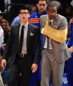 Jeremy Lin and Amare Stoudemire attend the Miami Heat vs New York Knicks Playoff Game at Madison Square Garden on May 3 2012 in New York City