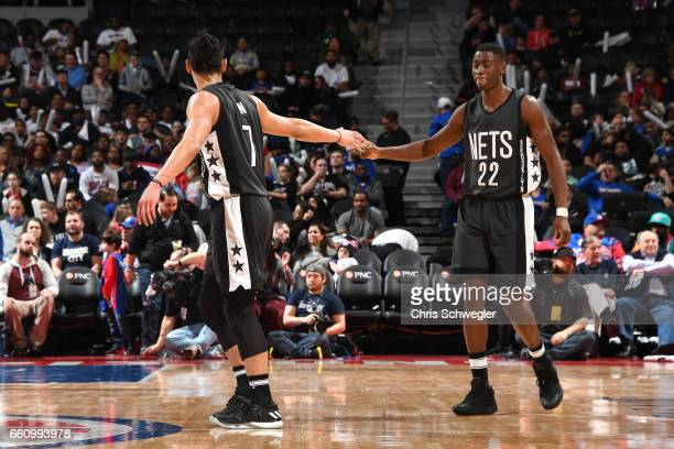 Jeremy Lin and Caris LeVert of the Brooklyn Nets high five each other during the game against the Detroit Pistons on March 30 2017 at The Palace of...
