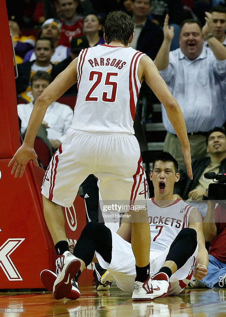 Jeremy Lin #7 and Chandler Parsons #25 of the Houston Rockets celebrate a basket against the Los Angeles Lakers at Toyota Center on January 8, 2013 in Houston, Texas.