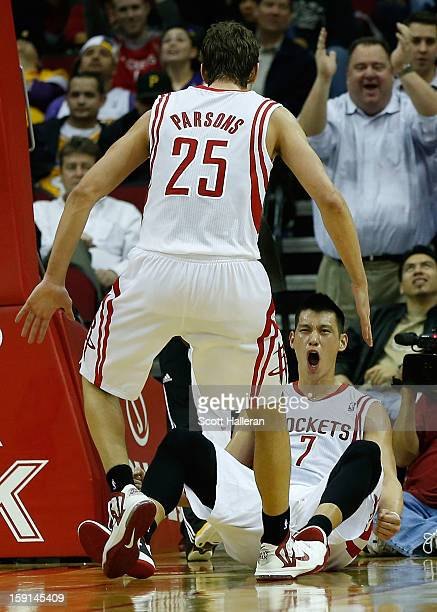 Jeremy Lin and Chandler Parsons of the Houston Rockets celebrate a basket against the Los Angeles Lakers at Toyota Center on January 8 2013 in...