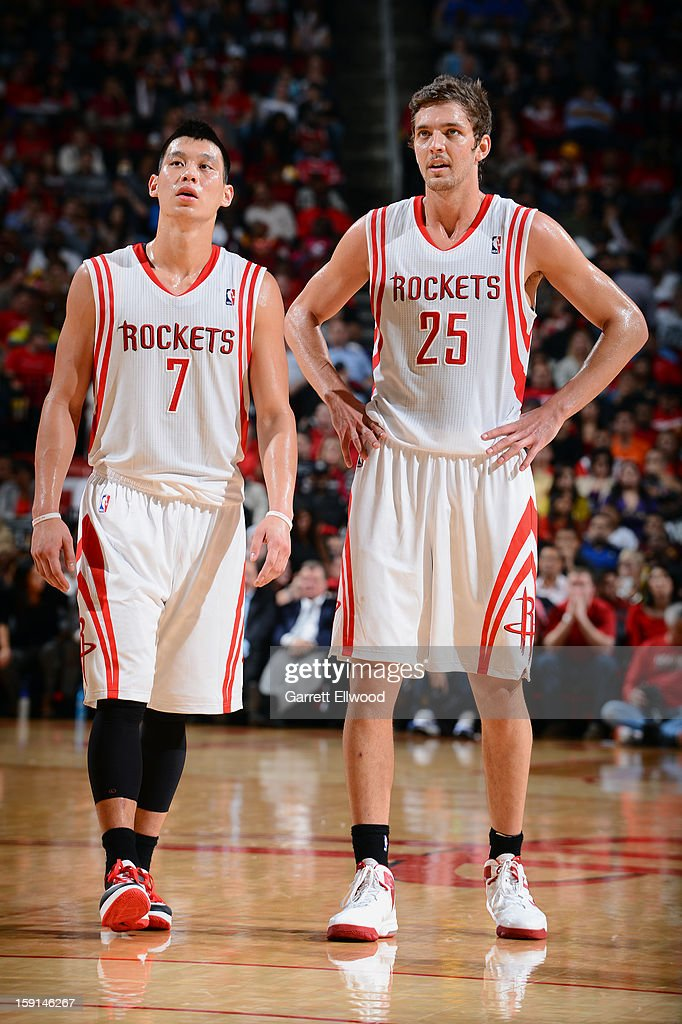 Jeremy Lin #7 and Chandler Parsons #25 of the Houston Rockets look on during the game against the Los Angeles Lakers on January 8, 2013 at the Toyota Center in Houston, Texas.