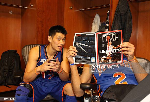 Jeremy Lin and Landry Fields of Team Shaq read a magazine before the BBVA Rising Stars Challenge as part of 2012 AllStar Weekend at the Amway Center...