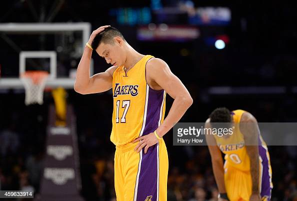 Jeremy Lin and Nick Young of the Los Angeles Lakers react during a 9993 loss to the Memphis Grizzlies at Staples Center on November 26 2014 in Los...