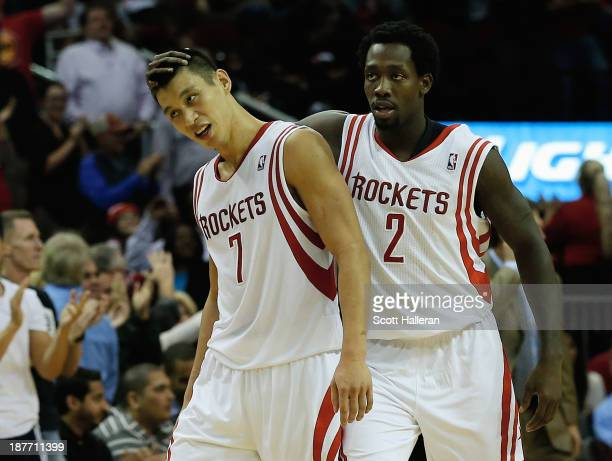 Jeremy Lin and Patrick Beverley of the Houston Rockets celebrate as time winds down in the second overtime period during the game against the Toronto...