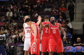 Jeremy Lin high fives teammate James Harden of the Houston Rockets during the game against the Detroit Pistons on October 31 2012 at The Palace of...