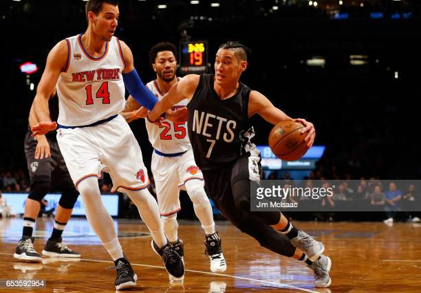 Jeremy Lin of the Brooklyn Nets in action against Willy Hernangomez of the New York Knicks at Barclays Center on March 12 2017 in the Brooklyn...