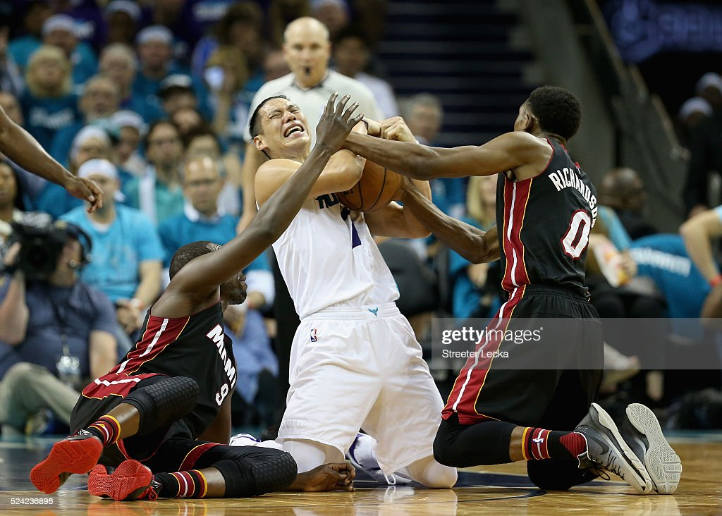 Jeremy Lin #7 of the Charlotte Hornets battles for a loose ball against teammates Luol Deng #9 and Josh Richardson #0 of the Miami Heat during game four of the Eastern Conference Quarterfinals of the 2016 NBA Playoffs at Time Warner Cable Arena on April 25, 2016 in Charlotte, North Carolina.