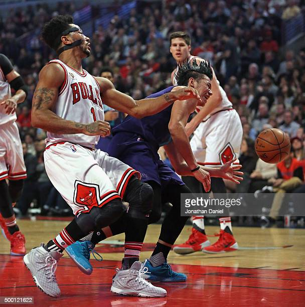 Jeremy Lin of the Charlotte Hornets is fouled by Derrick Rose of the Chicago Bulls at the United Center on December 5 2015 in Chicago Illinois Note...