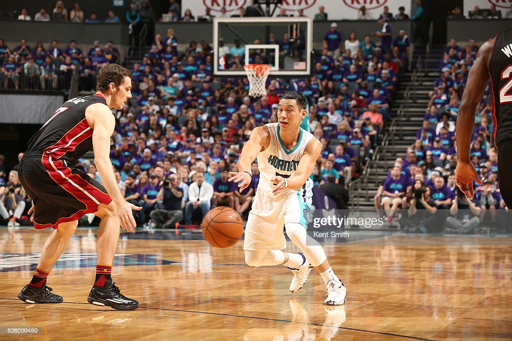 Jeremy Lin #7 of the Charlotte Hornets passes the ball against Goran Dragic #7 of the Miami Heat in Game Six of the Eastern Conference Quarterfinals during the 2016 NBA Playoffs on April 29, 2016 at Time Warner Cable Arena in Charlotte, North Carolina.