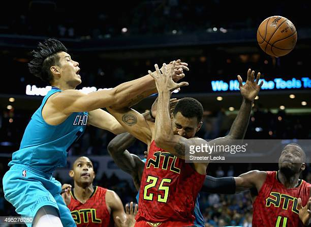 Jeremy Lin of the Charlotte Hornets tries to grab a loose ball over Thabo Sefolosha of the Atlanta Hawks during their game at Time Warner Cable Arena...