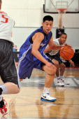 Jeremy Lin of the Dallas Mavericks drives to the basket against the Houston Rockets during NBA Summer League on July 10 2010 at Cox Pavilion in Las...