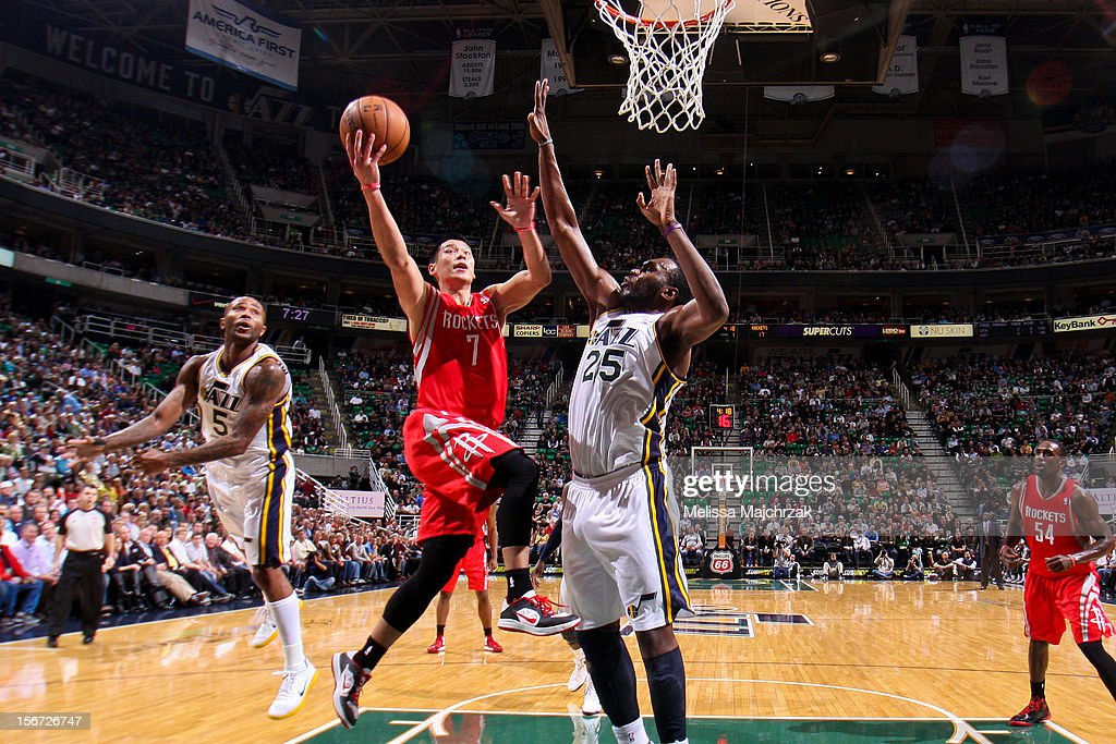 Jeremy Lin #7 of the Houston Rockets attempts a layup against Mo Williams #5 and Al Jefferson #25 of the Utah Jazz at Energy Solutions Arena on November 19, 2012 in Salt Lake City, Utah.