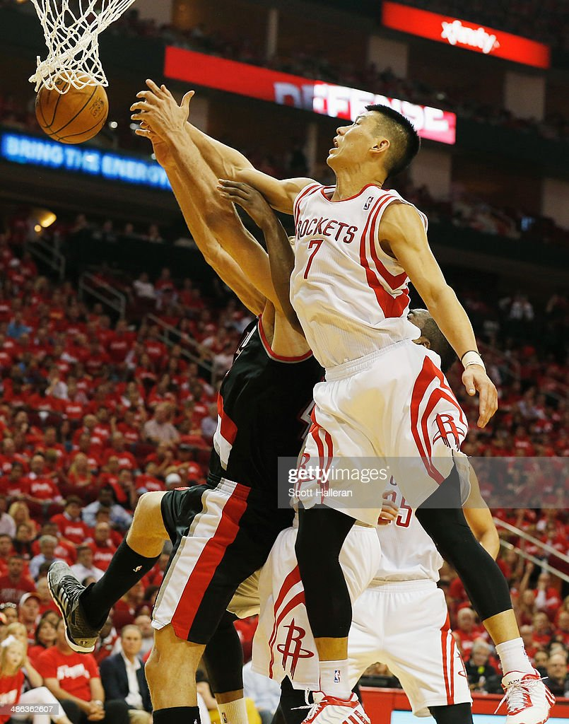 Jeremy Lin of the Houston Rockets battles for the ball against Robin Lopez of the Portland Trail Blazers during the first half in Game Two of the...