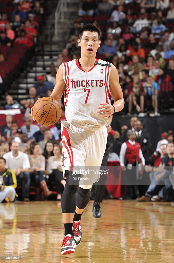 <a gi-track='captionPersonalityLinkClicked' href=/galleries/search?phrase=Jeremy+Lin&family=editorial&specificpeople=6669516 ng-click='$event.stopPropagation()'>Jeremy Lin</a> #7 of the Houston Rockets brings the ball up court against the Utah Jazz on December 1, 2012 at the Toyota Center in Houston, Texas.