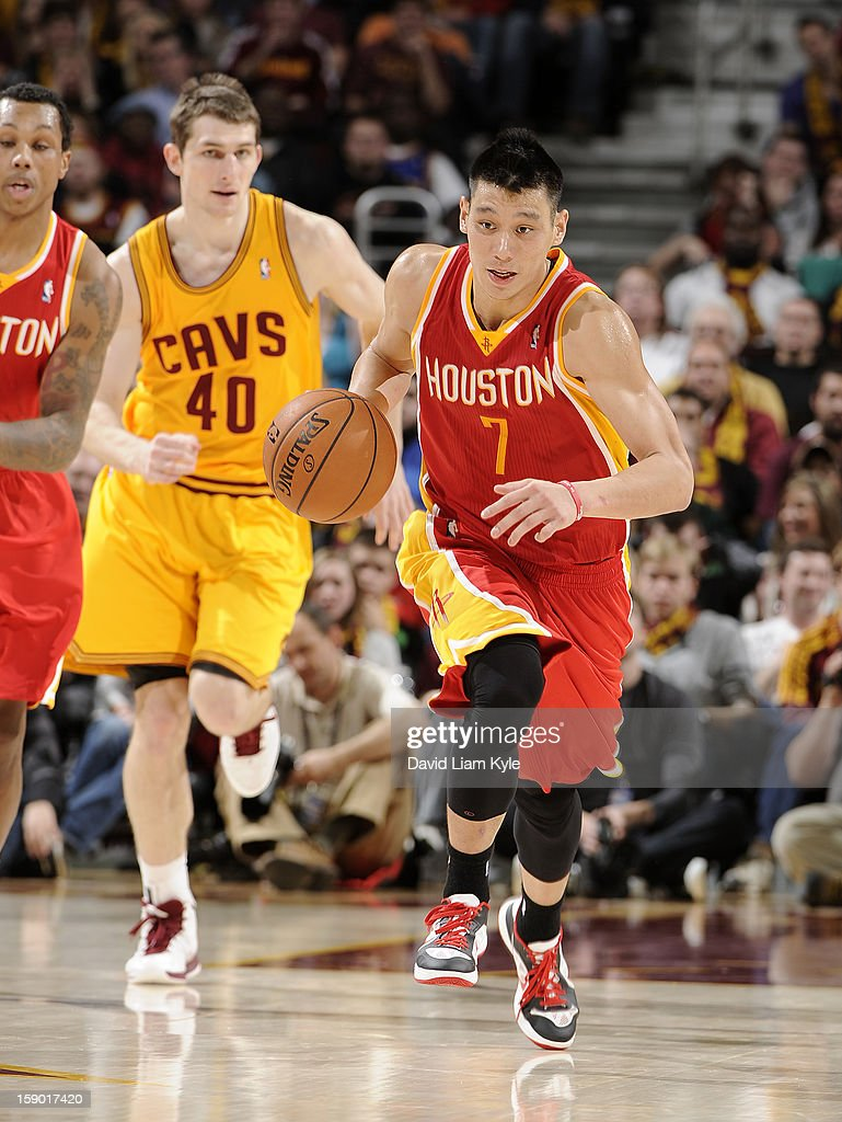 <a gi-track='captionPersonalityLinkClicked' href=/galleries/search?phrase=Jeremy+Lin&family=editorial&specificpeople=6669516 ng-click='$event.stopPropagation()'>Jeremy Lin</a> #7 of the Houston Rockets brings the ball up the court trailed by <a gi-track='captionPersonalityLinkClicked' href=/galleries/search?phrase=Tyler+Zeller&family=editorial&specificpeople=5122156 ng-click='$event.stopPropagation()'>Tyler Zeller</a> #40 of the Cleveland Cavaliers at The Quicken Loans Arena on January 5, 2013 in Cleveland, Ohio.