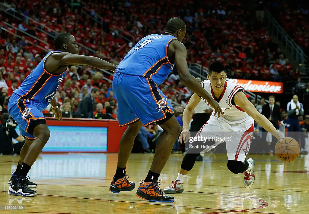 Jeremy Lin #7 of the Houston Rockets brings the ball upcourt against Reggie Jackson #15 and Serge Ibaka #9 of the Oklahoma City Thunder in Game Six of the Western Conference Quarterfinals of the 2013 NBA Playoffs at the Toyota Center on May 3, 2013 in Houston, Texas.