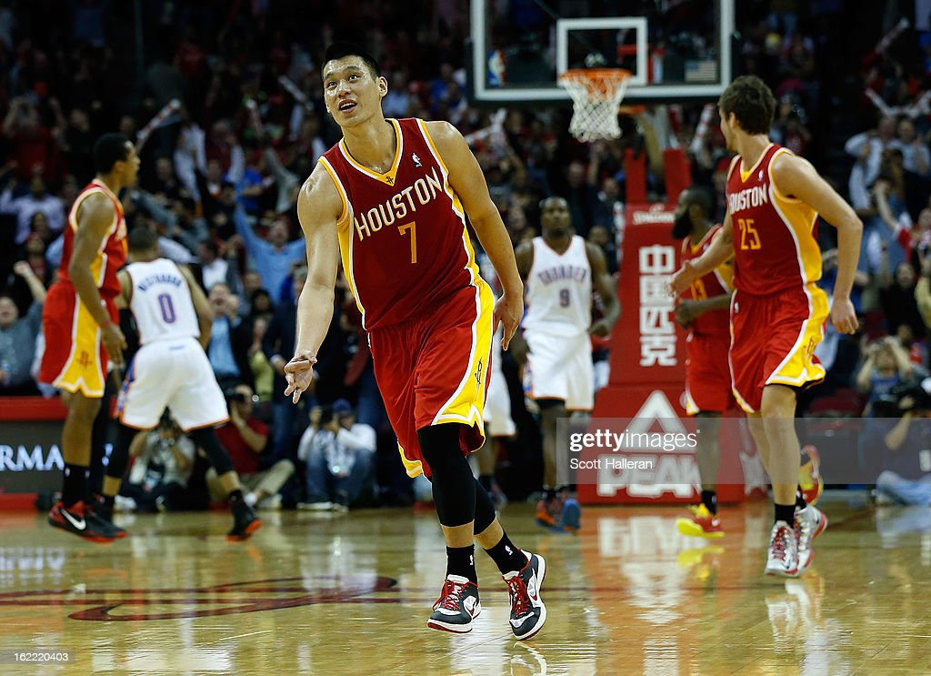 Jeremy Lin #7 (C) of the Houston Rockets celebrates a three point shot during the game against the Oklahoma City Thunder at Toyota Center on February 20, 2013 in Houston, Texas.