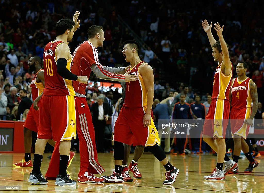 Jeremy Lin #7 (C) of the Houston Rockets celebrates a three point shot with his teammates during the game against the Oklahoma City Thunder at Toyota Center on February 20, 2013 in Houston, Texas.
