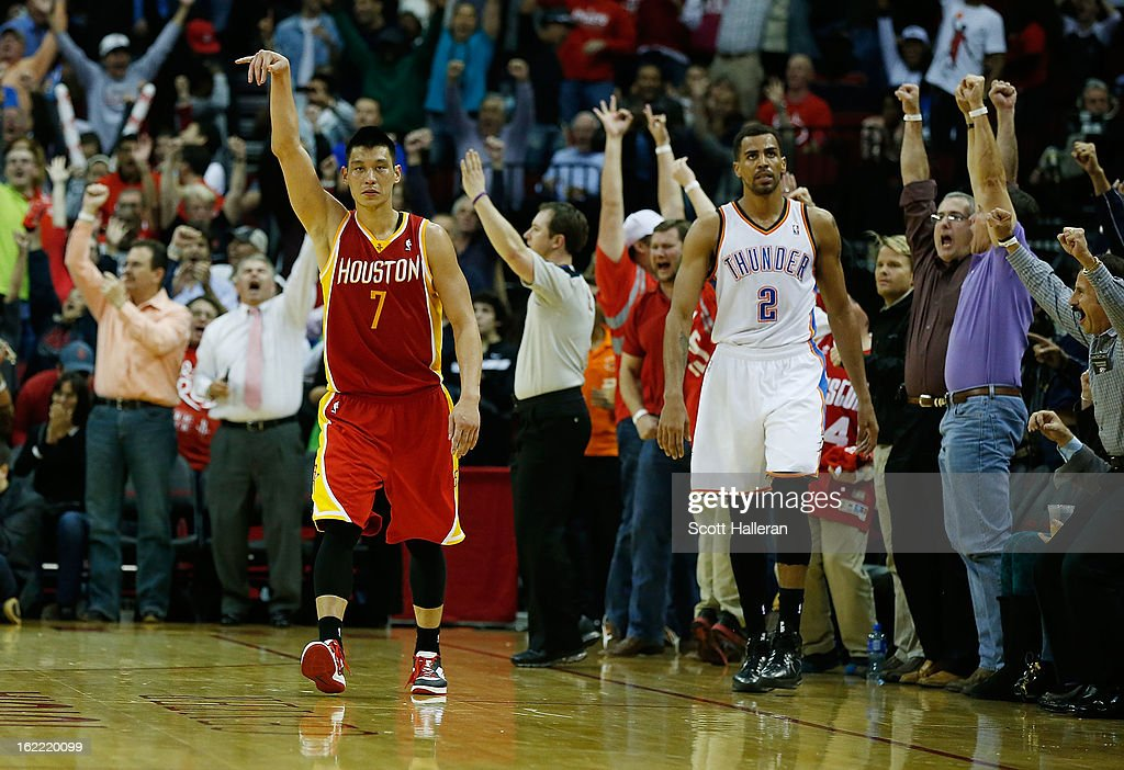 <a gi-track='captionPersonalityLinkClicked' href=/galleries/search?phrase=Jeremy+Lin&family=editorial&specificpeople=6669516 ng-click='$event.stopPropagation()'>Jeremy Lin</a> #7 of the Houston Rockets celebrates after a basket as <a gi-track='captionPersonalityLinkClicked' href=/galleries/search?phrase=Thabo+Sefolosha&family=editorial&specificpeople=587449 ng-click='$event.stopPropagation()'>Thabo Sefolosha</a> #2 of the Oklahoma City Thunder looks on at Toyota Center on February 20, 2013 in Houston, Texas.