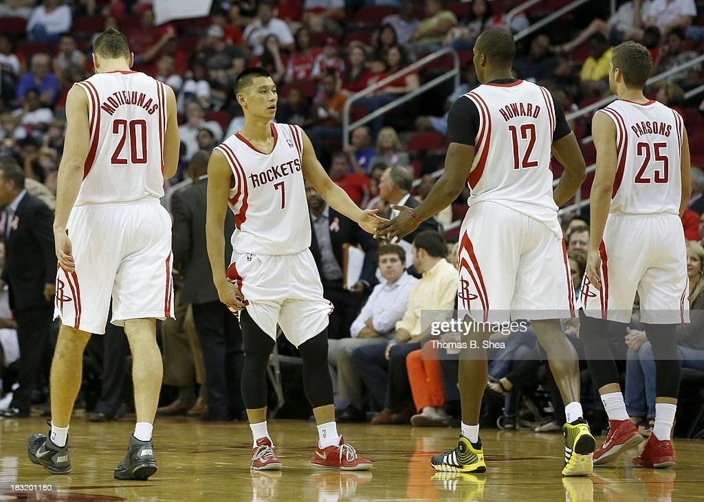 Jeremy Lin #7 of the Houston Rockets celebrates with Dwight Howard #12 of the Houston Rockets during action against the New Orleans Pelicans in a preseason NBA game on October 5, 2013 at Toyota Center in Houston, Texas. The Pelicans won 116-115.