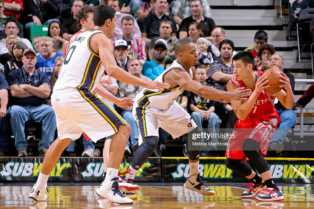 Jeremy Lin #7 of the Houston Rockets controls the ball against Randy Foye #8 and Enes Kanter #0 of the Utah Jazz at Energy Solutions Arena on November 19, 2012 in Salt Lake City, Utah.