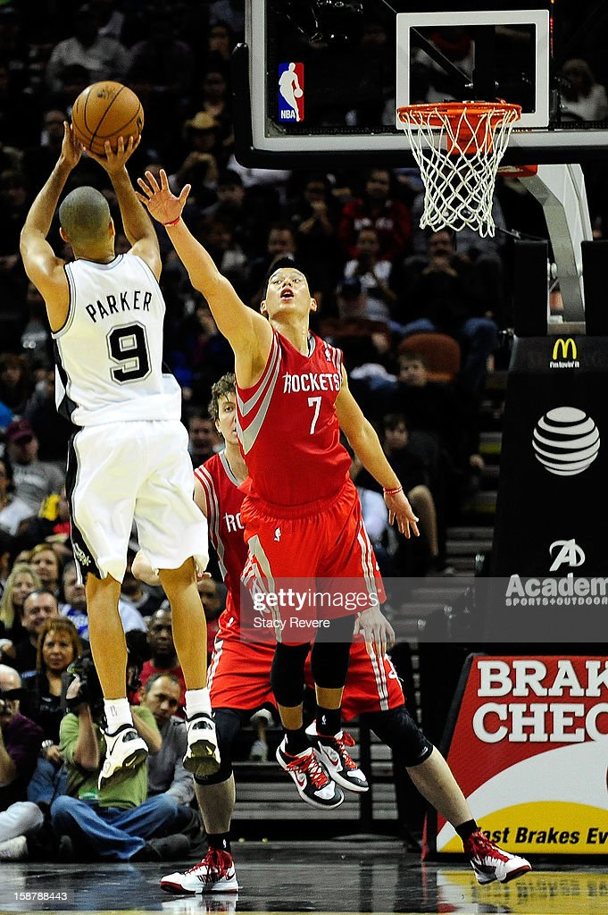 Jeremy Lin #7 of the Houston Rockets defends a shot by Tony Parker #9 of the San Antonio Spurs during a game at AT&T Center on December 28, 2012 in San Antonio, Texas.