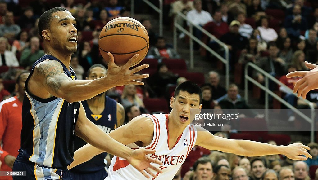 <a gi-track='captionPersonalityLinkClicked' href=/galleries/search?phrase=Jeremy+Lin&family=editorial&specificpeople=6669516 ng-click='$event.stopPropagation()'>Jeremy Lin</a> #7 of the Houston Rockets defends against <a gi-track='captionPersonalityLinkClicked' href=/galleries/search?phrase=Courtney+Lee&family=editorial&specificpeople=730223 ng-click='$event.stopPropagation()'>Courtney Lee</a> #5 of the Memphis Grizzlies during the game at the Toyota Center on January 24, 2014 in Houston, Texas.