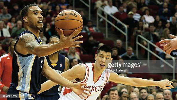 Jeremy Lin of the Houston Rockets defends against Courtney Lee of the Memphis Grizzlies during the game at the Toyota Center on January 24 2014 in...