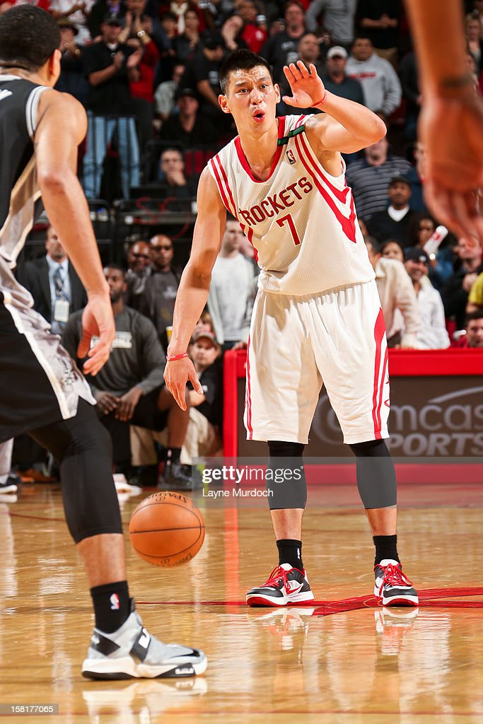 <a gi-track='captionPersonalityLinkClicked' href=/galleries/search?phrase=Jeremy+Lin&family=editorial&specificpeople=6669516 ng-click='$event.stopPropagation()'>Jeremy Lin</a> #7 of the Houston Rockets directs his teammates against the San Antonio Spurs on December 10, 2012 at the Toyota Center in Houston, Texas.