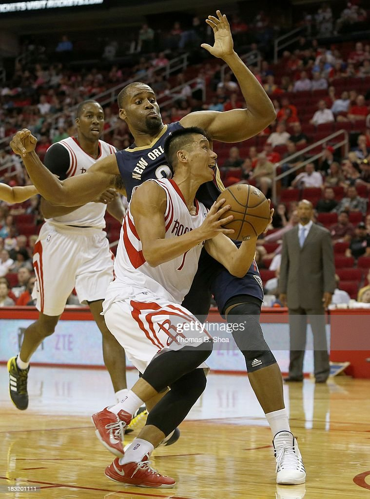 Jeremy Lin #7 of the Houston Rockets drives against Darius Miller #2 of the New Orleans Pelicans in a preseason NBA game on October 5, 2013 at Toyota Center in Houston, Texas. The Pelicans won 116-115.