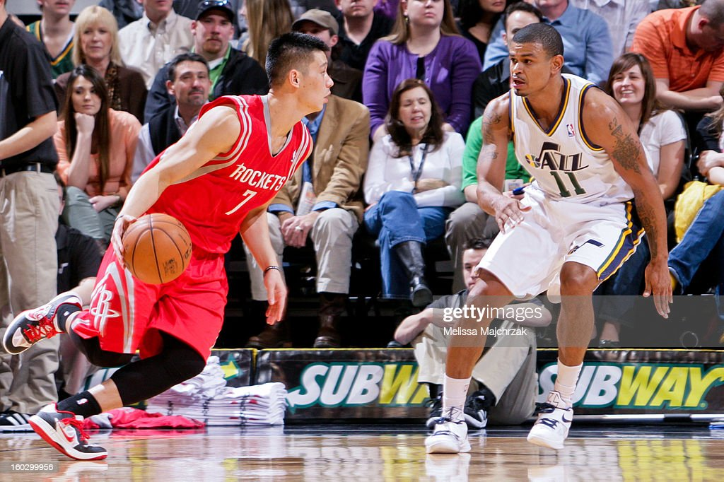 Jeremy Lin #7 of the Houston Rockets drives against Earl Watson #11 of the Utah Jazz at Energy Solutions Arena on January 28, 2013 in Salt Lake City, Utah.