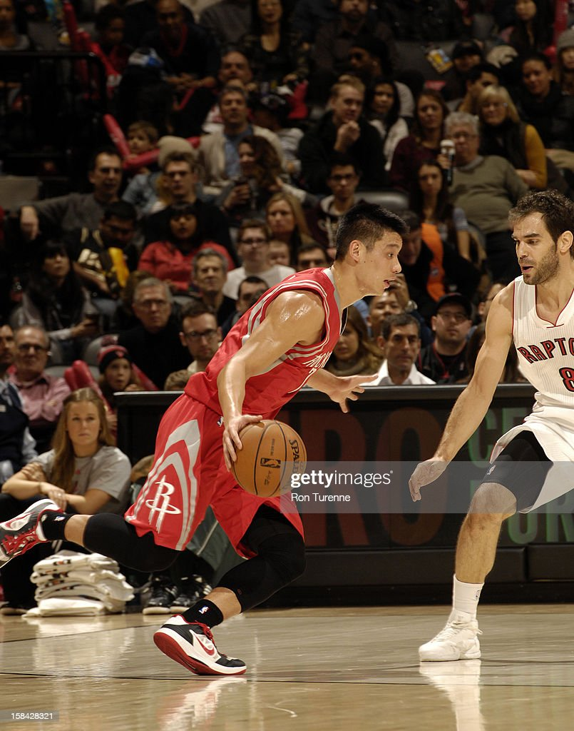Jeremy Lin #7 of the Houston Rockets drives against Jose Calderon #8 of the Toronto Raptors during the game between the Toronto Raptors and the Houston Rockets December 16, 2012 at the Air Canada Centre in Toronto, Ontario, Canada.