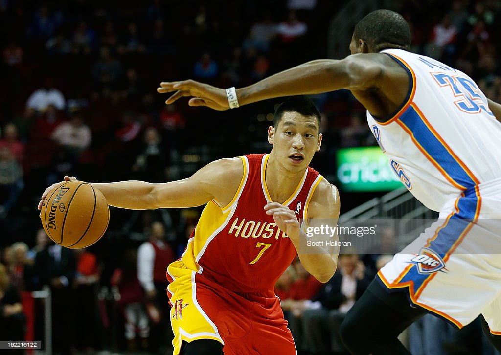 Jeremy Lin #7 of the Houston Rockets drives against Kevin Durant #35 of the Oklahoma City Thunder at Toyota Center on February 20, 2013 in Houston, Texas.