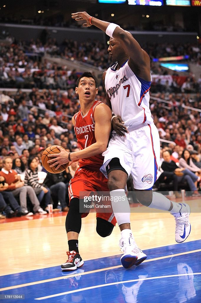 <a gi-track='captionPersonalityLinkClicked' href=/galleries/search?phrase=Jeremy+Lin&family=editorial&specificpeople=6669516 ng-click='$event.stopPropagation()'>Jeremy Lin</a> #7 of the Houston Rockets drives against <a gi-track='captionPersonalityLinkClicked' href=/galleries/search?phrase=Lamar+Odom&family=editorial&specificpeople=201519 ng-click='$event.stopPropagation()'>Lamar Odom</a> #7 of the Los Angeles Clippers during the game between the Los Angeles Clippers and the Houston Rockets at Staples Center on February 13, 2013 in Los Angeles, California.