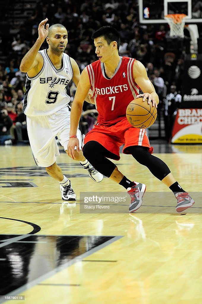 Jeremy Lin #7 of the Houston Rockets drives around Tony Parker #9 of the San Antonio Spurs during a game at AT&T Center on December 28, 2012 in San Antonio, Texas. San Antonio won the game 122-116.
