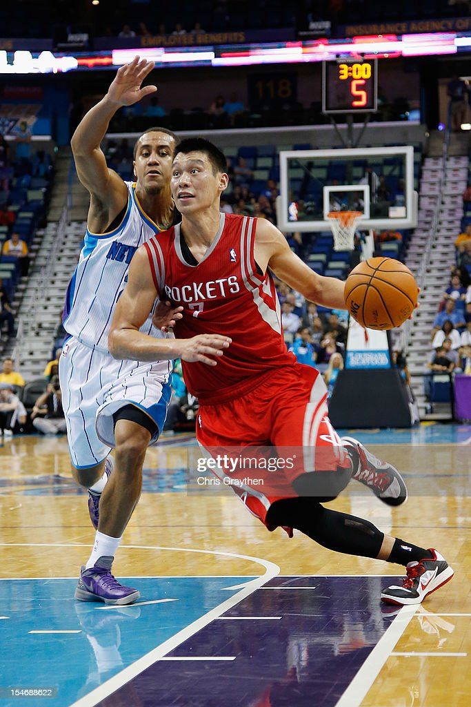 <a gi-track='captionPersonalityLinkClicked' href=/galleries/search?phrase=Jeremy+Lin&family=editorial&specificpeople=6669516 ng-click='$event.stopPropagation()'>Jeremy Lin</a> #7 of the Houston Rockets drives the ball around Brian Roberts #22 of the New Orleans Hornets at New Orleans Arena on October 24, 2012 in New Orleans, Louisiana.