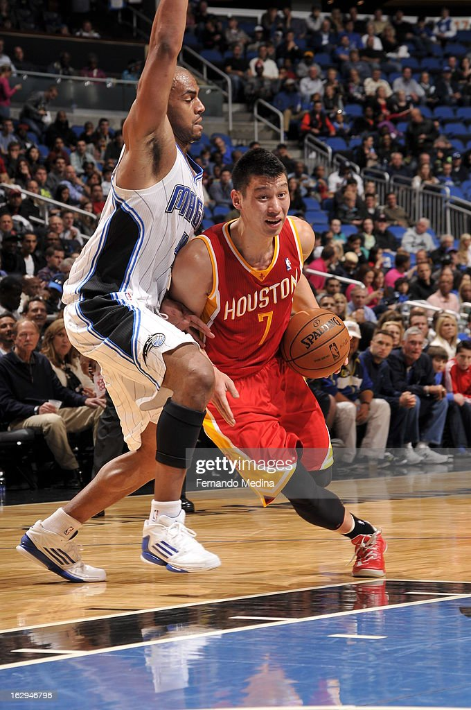 Jeremy Lin #7 of the Houston Rockets drives to the basket against Arron Afflalo #4 of the Orlando Magic during the game on March 1, 2013 at Amway Center in Orlando, Florida.