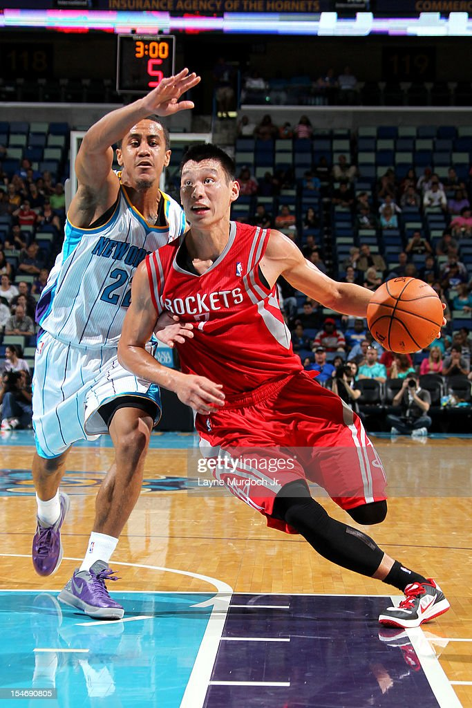 <a gi-track='captionPersonalityLinkClicked' href=/galleries/search?phrase=Jeremy+Lin&family=editorial&specificpeople=6669516 ng-click='$event.stopPropagation()'>Jeremy Lin</a> #7 of the Houston Rockets drives to the basket against Brian Roberts #22 of the New Orleans Hornets on October 24, 2012 at the New Orleans Arena in New Orleans, Louisiana.