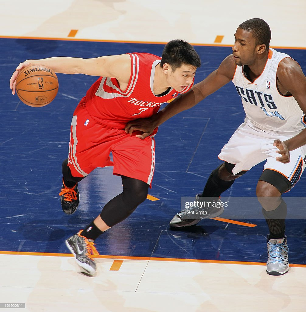 Jeremy Lin #7 of the Houston Rockets drives to the basket against Michael Kidd-Gilchrist #14 of the Charlotte Bobcats at the Time Warner Cable Arena on January 21, 2013 in Charlotte, North Carolina.