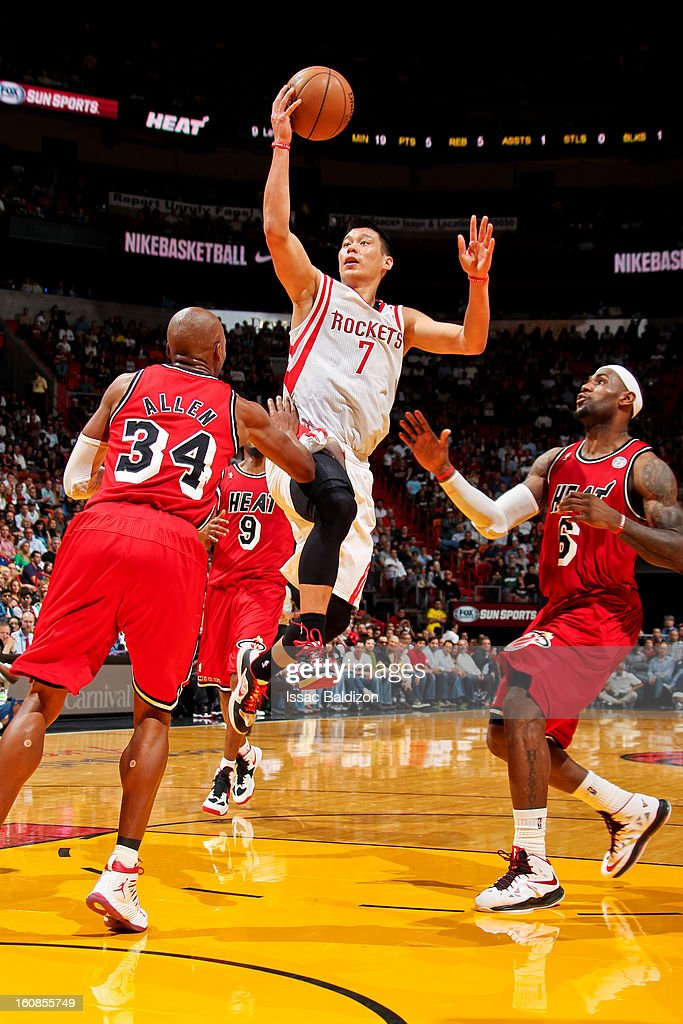 Jeremy Lin #7 of the Houston Rockets drives to the basket against Ray Allen #34 and LeBron James #6 of the Miami Heat on February 6, 2013 at American Airlines Arena in Miami, Florida.